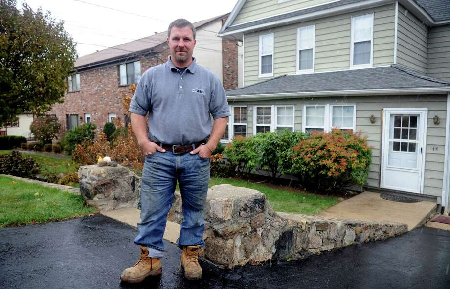 Bruce Vetti poses for a photo outside his Stamford, Conn., home on Wednesday, November 7, 2012. Vetti shared his generator with his neighbor during their power outage due to Superstorm Sandy. Photo: Lindsay Niegelberg / Stamford Advocate