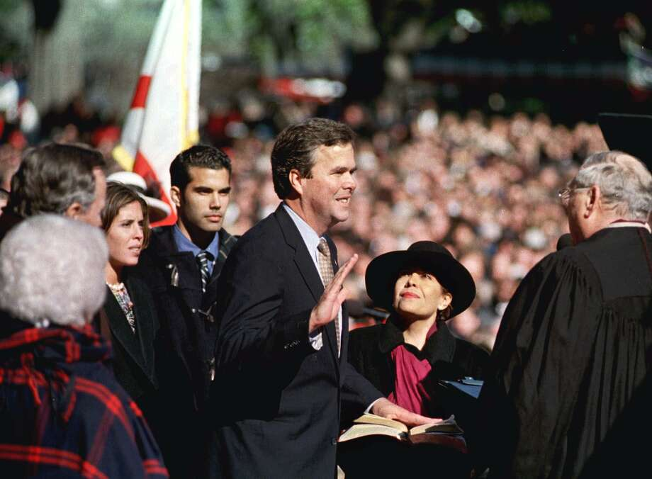 Bush, his sister, Noelle, and their mother, Columba watch Jeb Bush get sworn in as Florida's governor in 1999.