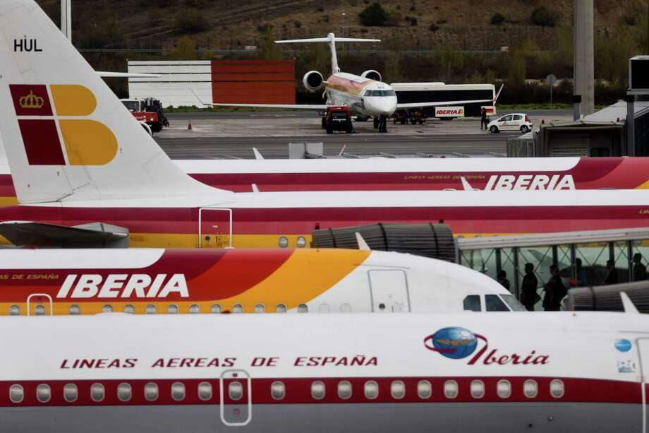 Iberia jets wait at the international airport in Madrid. The Spanish carrier may cut 4,500 jobs. Photo: Daniel Ochoa De Olza, STF / AP