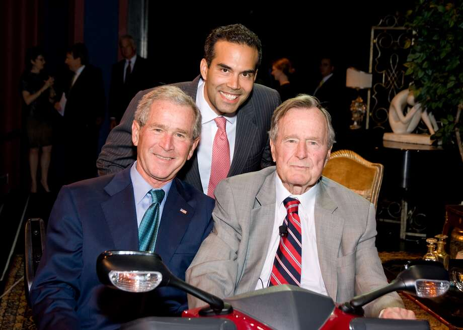 Bush with his uncle and grandfather at a fundraiser for Barbara Bush's literacy causes.