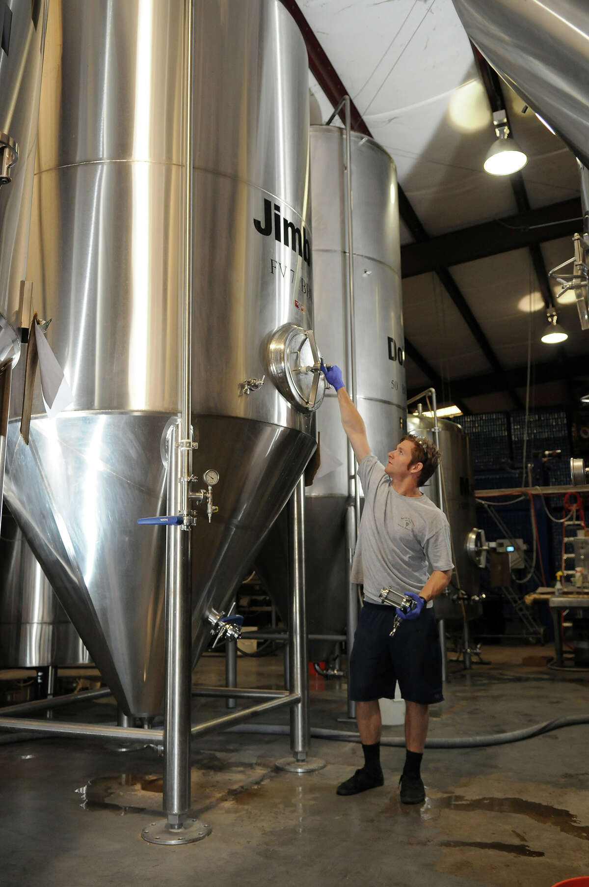 Brewer Jeff Hamm checks the pressure on a fermentation vessel in the tank farm at the Southern Star Brewery in Conroe.