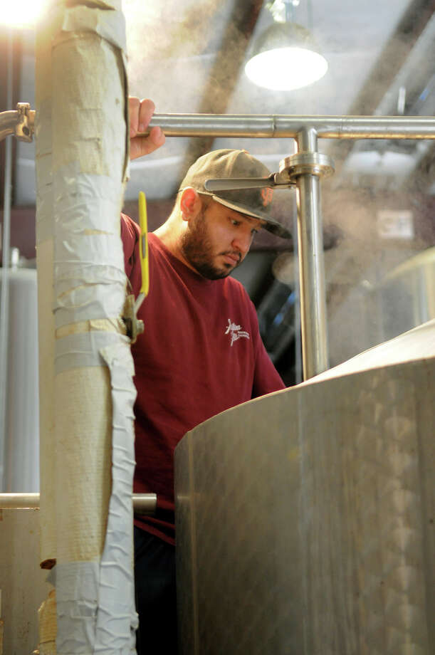 Jason Gutierrez monitors a brew kettle during a beer cooking session at the Southern Star Brewery. Photo: Jerry Baker, Freelance