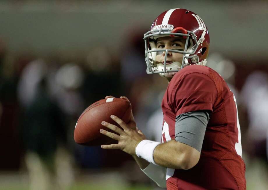 Quarterback AJ McCarron's ability to run the play-action offense is key to Alabama's success. Photo: Dave Martin, STF / AP