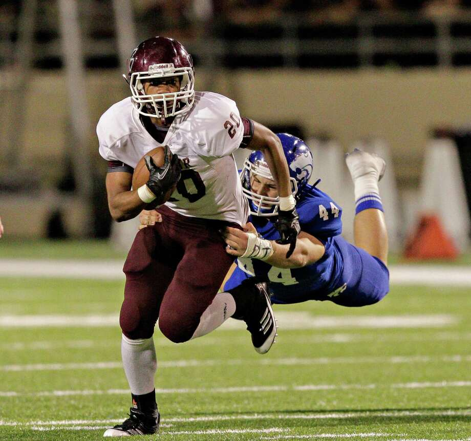 Cy-Fair's Dillon Birden #20 is tackled from behind by  Cy-Creek's Brandon Brown #44 during 17-5A action between Cy-Fair and Cypress Creek on Friday, November 9, 2012 at Pridgeon  Stadium in Houston, Texas. Cy-Fair defeats Cy-Creek. Photo: Bob Levey, Houston Chronicle / ©2012 Bob Levey