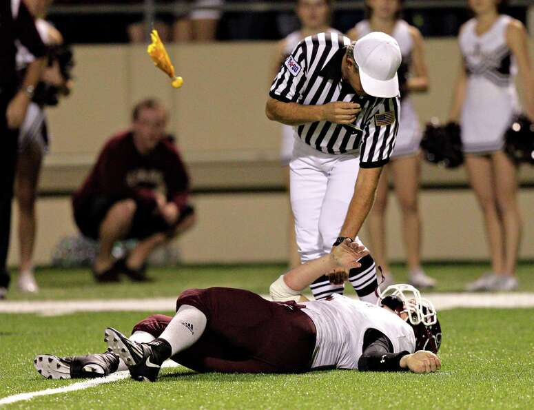 Cy-Fair quarterback Logan Taylor lays on the field after taking a hard hit during 17-5A action betwe