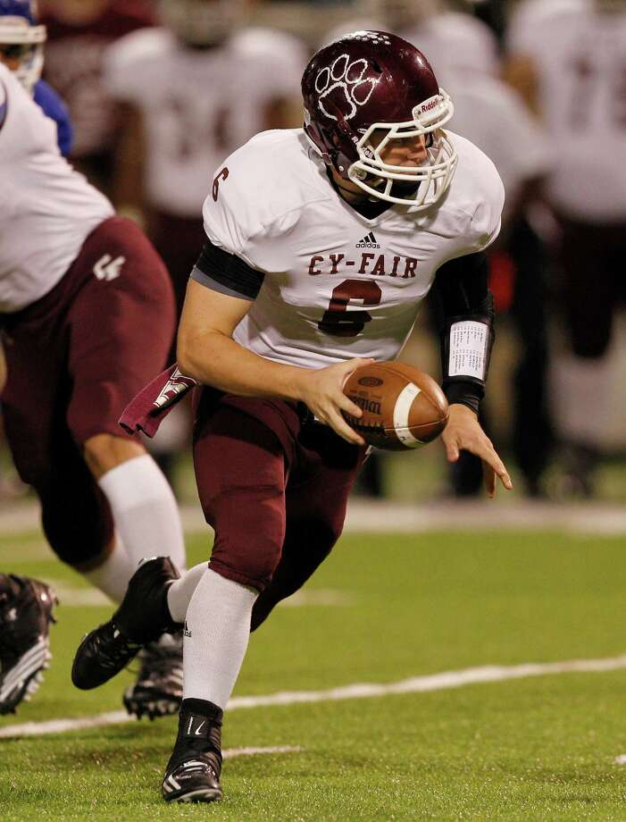Cy Fair quarterback Logan Taylor #6 looks to hand off during 17-5A action between Cy-Fair and Cypress Creek on Friday, November 9, 2012 at Pridgeon  Stadium in Houston, Texas. Photo: Bob Levey, Houston Chronicle / ©2012 Bob Levey