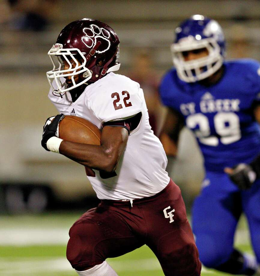 Cy-Fair running back Jacorey Aleem #22 rushes against Cypress Creek during 17-5A action between Cy-Fair and Cypress Creek on Friday, November 9, 2012 at Pridgeon  Stadium in Houston, Texas. Photo: Bob Levey, Houston Chronicle / ©2012 Bob Levey