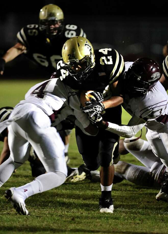 Nederland running back Kendrick Hopkins, 24, pushes through the Jaguars for a touchdown during the Nederland High School football game against Central High School in Nederland on Friday, November 9, 2012. Photo taken: Randy Edwards/The Enterprise Photo: Randy Edwards