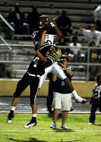 Nederland defensive player Seth Barrow, 4, is flagged for pass interference during the Nederland High School football game against Central High School in Nederland on Friday, November 9, 2012. Photo taken: Randy Edwards/The Enterprise Photo: Randy Edwards