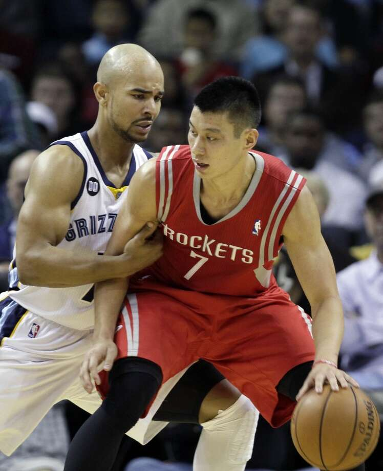 Rockets guard Jeremy Lin tries to escape the defense of Jerryd Bayless of the Grizzlies. (Daniel Johnston / Associated Press)