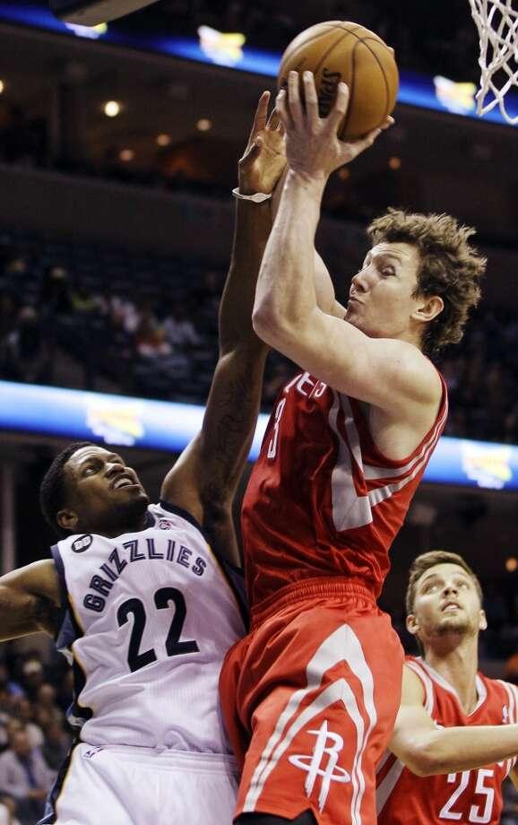 Rockets center Omer Asik shoots over Rudy Gay of the Grizzlies. (Daniel Johnston / Associated Press)