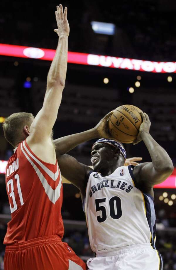 Grizzlies forward Zach Randolph tries to outmuscle Cole Aldrich of the Rockets. (Daniel Johnston / Associated Press)