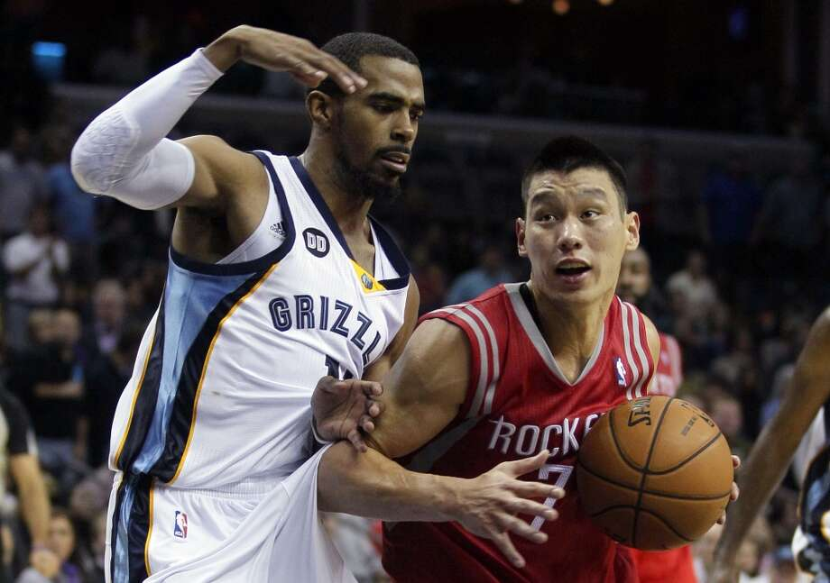 Jeremy Lin of the Rockets tries to get past Michael Conley of the Grizzlies. (Daniel Johnston / Associated Press)