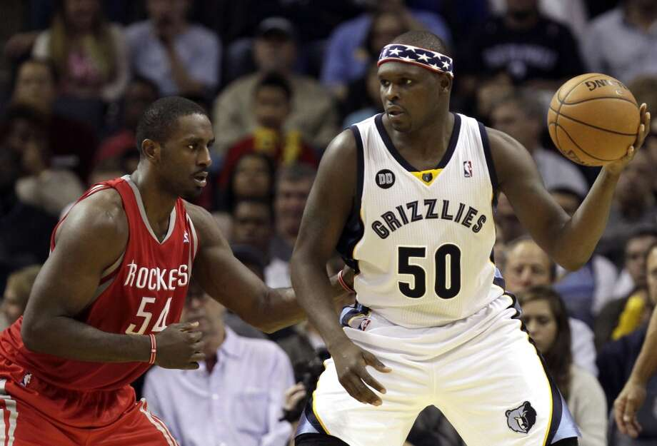 Grizzlies forward Zach Randolph tries to post up Rockets forward Patrick Patterson. (Daniel Johnston / Associated Press)
