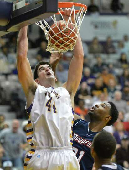 UAlbany's #44 John Puk scores during the final minutes of their opening season game against Duquesne