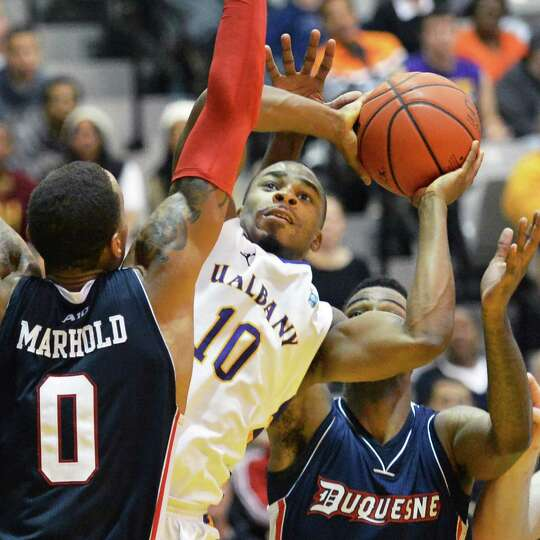 UAlbany's #10 Mike Black struggles to get a shot off against Duquesne at the Sefcu Arena in Albany F