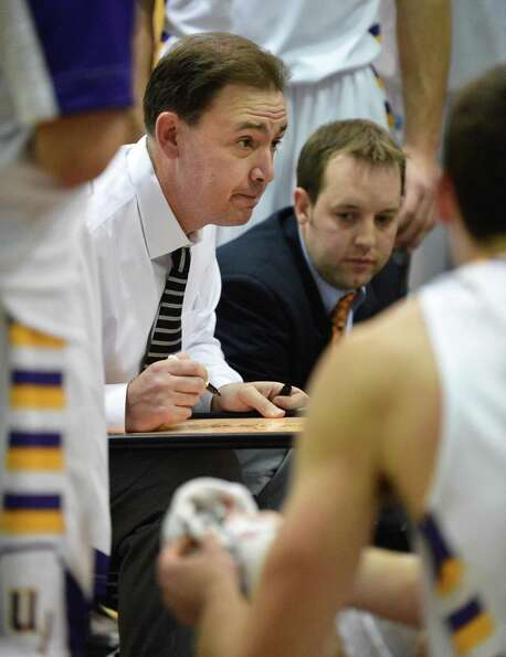 UAlbany head coach Will Brown with his players during a time out in the final minutes of their openi