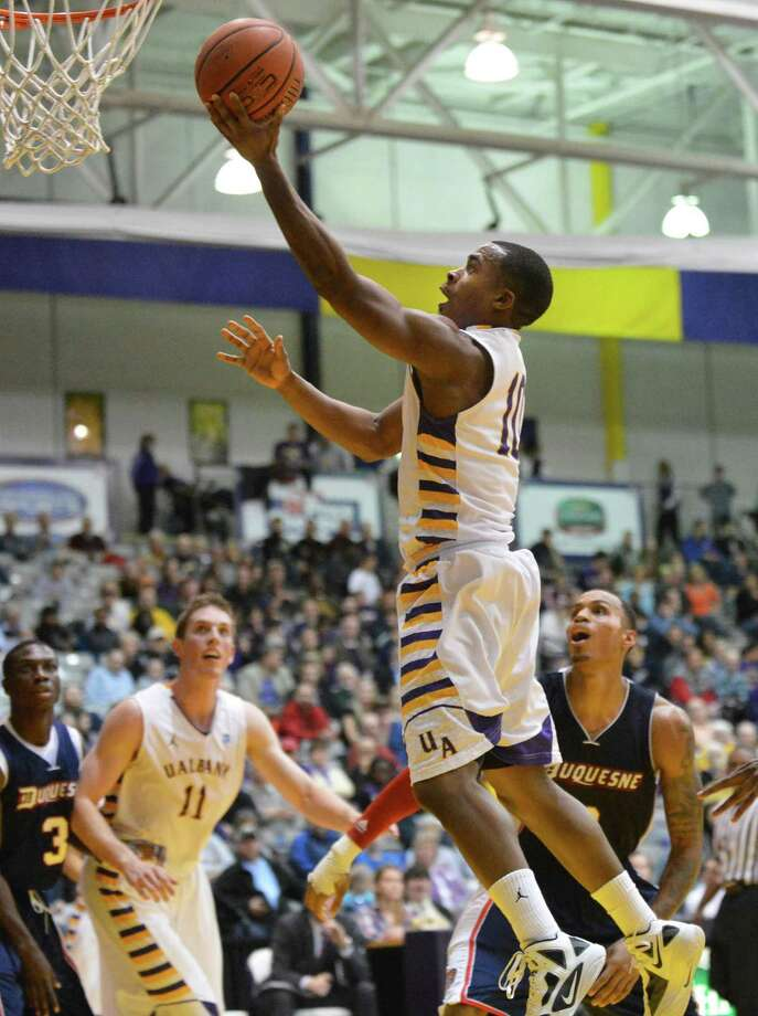 UAlbany's #10 Mike Black goes to the basket against Duquesne at the Sefcu Arena in Albany Friday Nov. 9, 2012.   (John Carl D'Annibale / Times Union) Photo: John Carl D'Annibale / 10019888A