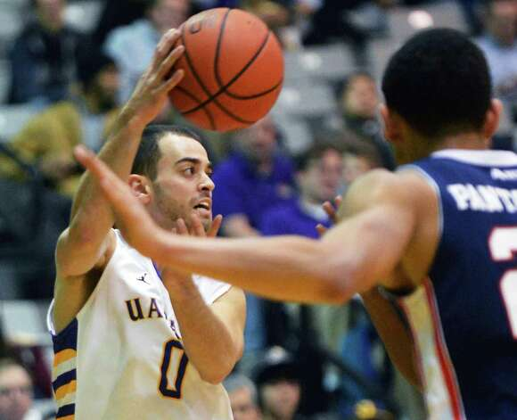 UAlbany's #0 Jacob Iati gets off a pass against Duquesne at the Sefcu Arena in Albany Friday Nov. 9, 2012.   (John Carl D'Annibale / Times Union) Photo: John Carl D'Annibale / 10019888A