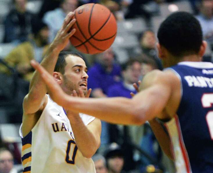 UAlbany's #0 Jacob Iati gets off a pass against Duquesne at the Sefcu Arena in Albany Friday Nov. 9,
