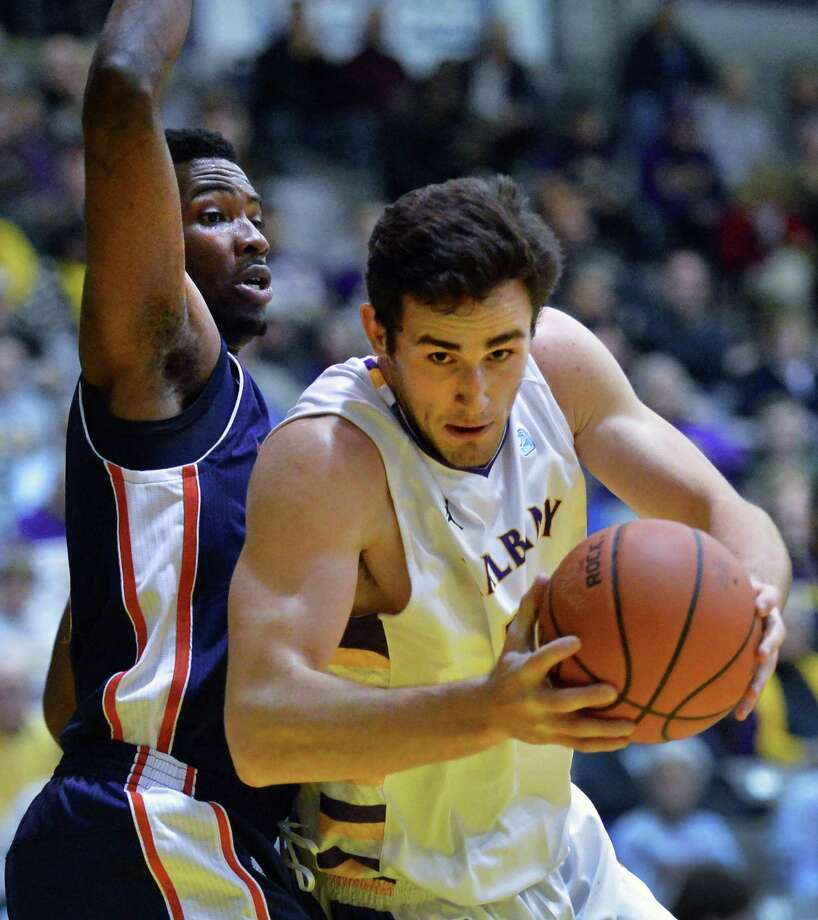 UAlbany's #14 Sam Rowley gets around Duquesne's #21 Quevyn Winters, left, during their opening season game at the Sefcu Arena in Albany Friday Nov. 9, 2012.   (John Carl D'Annibale / Times Union) Photo: John Carl D'Annibale / 10019888A