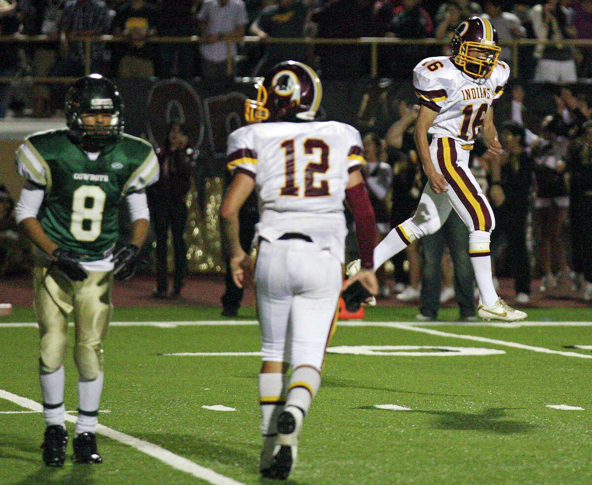 Harlandale's Rueben Garcia (right) reacts after making a field goal to tie the game 29-29 late in second half action of the Frontier Bowl as McCollum's Noe Trevino (left) and Harlandale's Brandon Ramon look on Friday Nov. 9, 2012 at Harlandale Memorial Stadium. Harlandale won in double overtime 43-36.