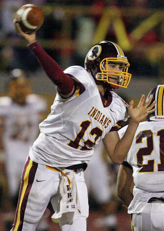 Harlandale's Brandon Ramon passes against McCollum during second half action of the Frontier Bowl Friday Nov. 9, 2012 at Harlandale Memorial Stadium. Harlandale won in double overtime 43-36. Photo: Edward A. Ornelas, Express-News / © 2012 San Antonio Express-News