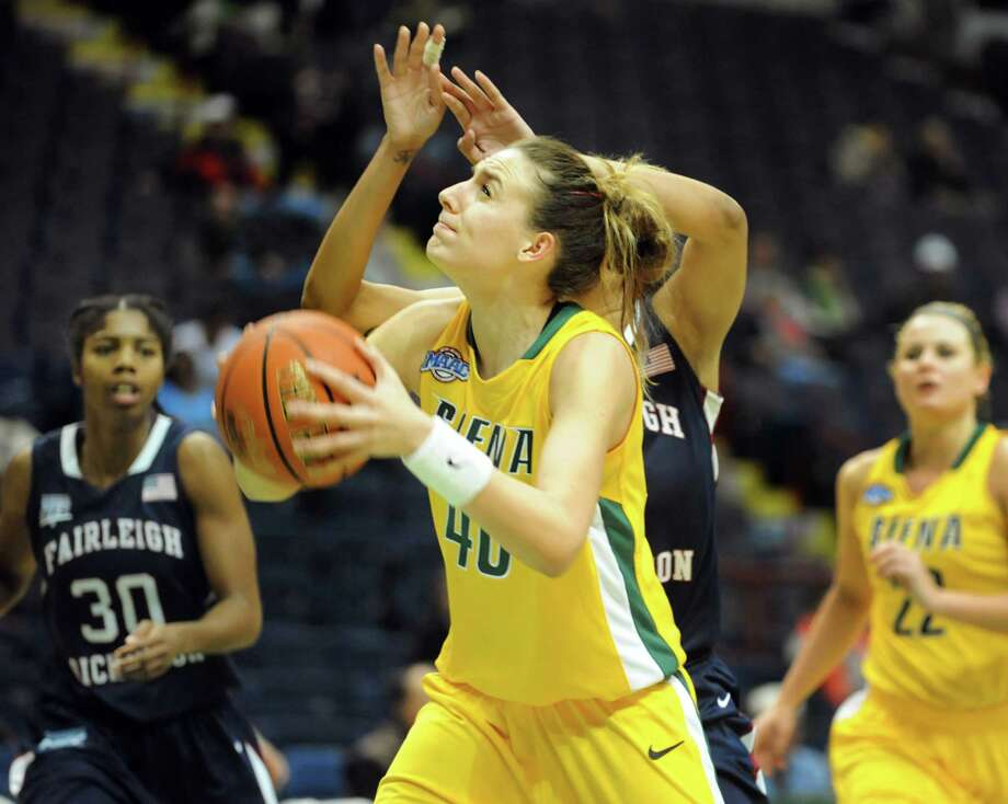 Siena's Clara Sole Anglada (40), center, looks to the hoop during their basketball game against Fairleigh Dickinson on Friday, Nov. 9, 2012, at Times Union Center in Albany, N.Y. (Cindy Schultz / Times Union) Photo: Cindy Schultz / 00019961A