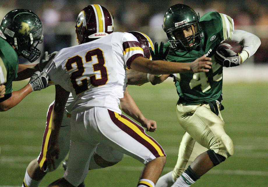 McCollum's Bobby Garza looks for room around Harlandale's Michael Ramos during second half action of the Frontier Bowl Friday Nov. 9, 2012 at Harlandale Memorial Stadium. Harlandale won in double overtime 43-36. Photo: Edward A. Ornelas, Express-News / © 2012 San Antonio Express-News