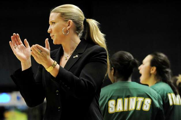 Siena's coach Ali Jaques, left, applauds her team when they win their basketball game 76-56 over Fairleigh Dickinson on Friday, Nov. 9, 2012, at Times Union Center in Albany, N.Y. (Cindy Schultz / Times Union) Photo: Cindy Schultz / 00019961A