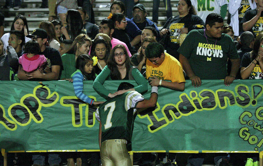 McCollum's Conrad Garcia is comforted by fans after the Frontier Bowl with Harlandale Friday Nov. 9, 2012 at Harlandale Memorial Stadium. Harlandale won in double overtime 43-36. Photo: Edward A. Ornelas, Express-News / © 2012 San Antonio Express-News