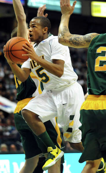 Siena's Evan Hymes (5) goes to the hoop during their basketball home opener against Vermont on Frida