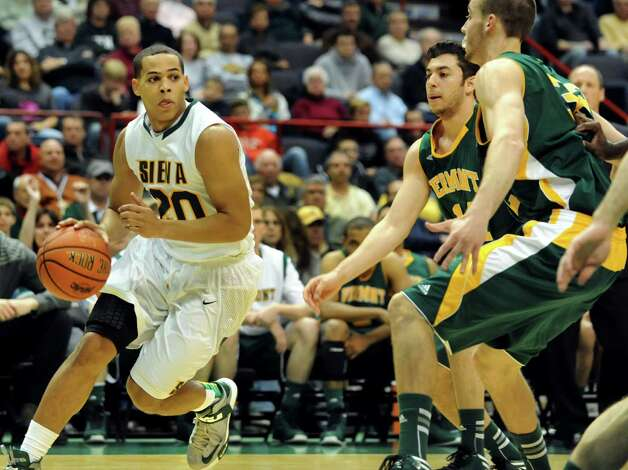 Siena's Chris Leppanen (20), left, looks to pass during their basketball home opener against Vermont on Friday, Nov. 9, 2012, at Times Union Center in Albany, N.Y. (Cindy Schultz / Times Union) Photo: Cindy Schultz / 00019962A