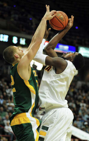 Siena's O.D. Anosike (1), right, and Vermont's Ethan O'Day (32), left, go toe to toe during their basketball game on Friday, Nov. 9, 2012, at Times Union Center in Albany, N.Y. (Cindy Schultz / Times Union) Photo: Cindy Schultz / 00019962A