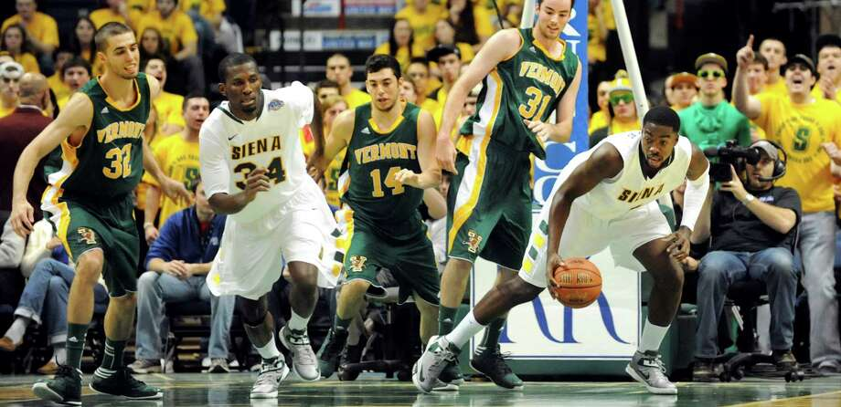 Siena's O.D. Anosike (1), right, gets the ball and turns to drive up court during their basketball game against Vermont on Friday, Nov. 9, 2012, at Times Union Center in Albany, N.Y. (Cindy Schultz / Times Union) Photo: Cindy Schultz / 00019962A