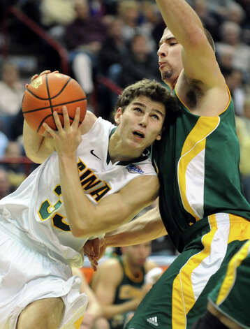 Siena's Rob Poole (33), left, struggles to get past Vermont's Brian Voelkel (1) during their basketball game on Friday, Nov. 9, 2012, at Times Union Center in Albany, N.Y. (Cindy Schultz / Times Union) Photo: Cindy Schultz / 00019962A