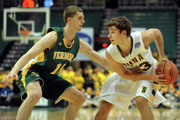 Siena's Rob Poole (33), right, looks to pass as Vermont's Brendan Kilpatrick (15) defends during their basketball game on Friday, Nov. 9, 2012, at Times Union Center in Albany, N.Y. (Cindy Schultz / Times Union) Photo: Cindy Schultz / 00019962A