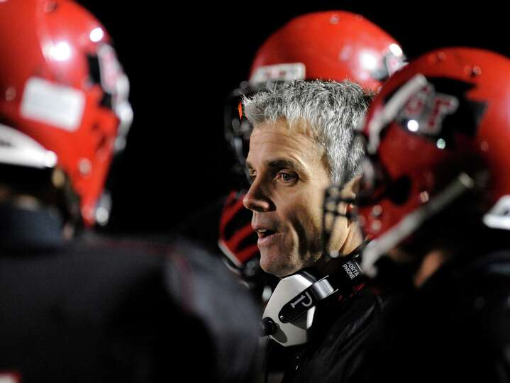 Glens Falls' head coach Pat Lilac coaches his team against Peru during their football game in Clifto