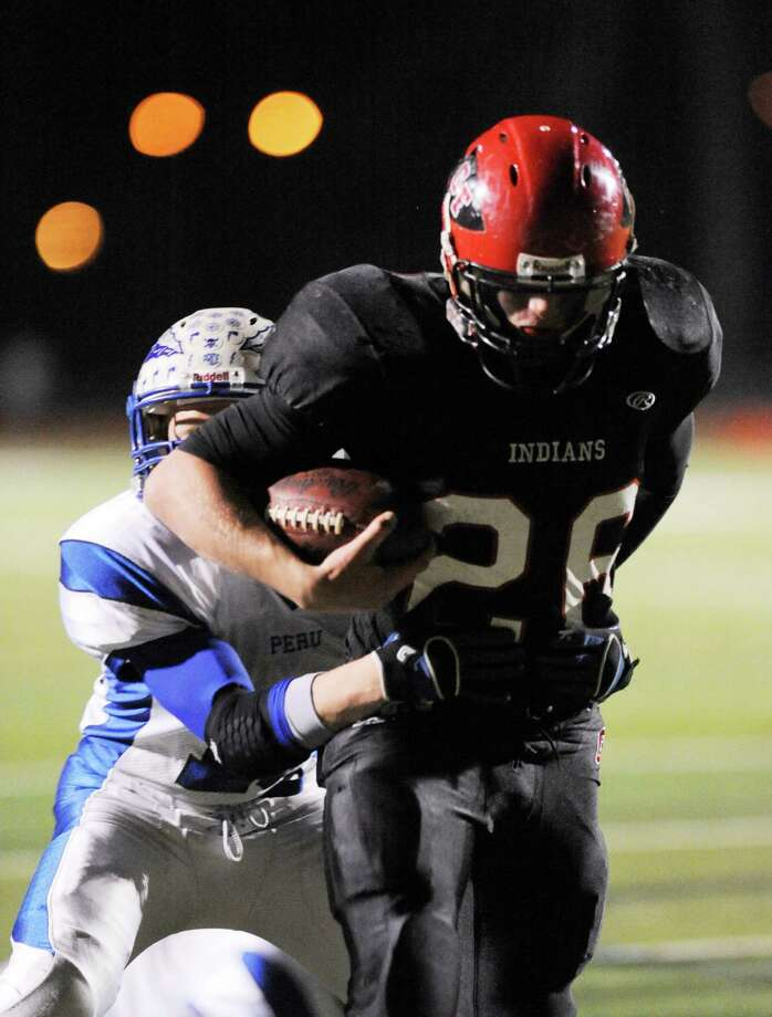 Glens Falls' Joe McMahon (26) runs for a touchdown against Peru during their football game in Clifton Park, N.Y., Friday, Nov.. 9, 2012. (Hans Pennink / Special to the Times Union) High School Sports. Photo: Hans Pennink / Hans Pennink