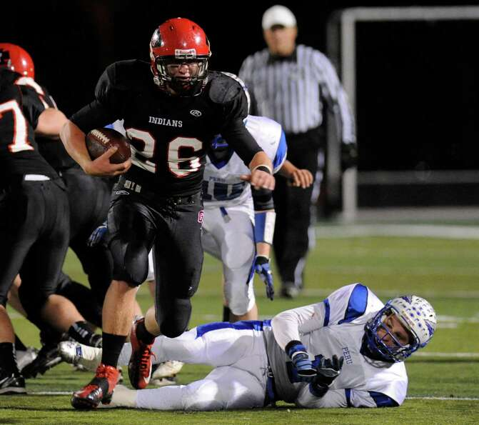 Glens Falls' Joe McMahon (26) runs for his second touchdown against Peru during their football game