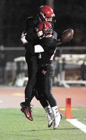 Glens Falls' Jake Dailey ,top, celebrates his touchdown  with teammate Matt Girard against Peru duri