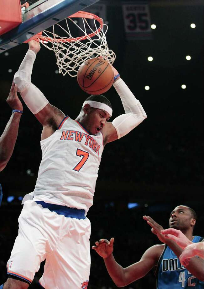 New York Knicks' Carmelo Anthony (7) dunks in front of Dallas Mavericks' Elton Brand during the first half of an NBA basketball game Friday, Nov. 9, 2012, in New York.  (AP Photo/Frank Franklin II) Photo: Frank Franklin II