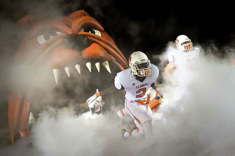 Ellis Hutchinson (2) and La Porte knocked off Port Arthur Memorial 37-33 on Friday night to claim their second straight District 21-5A title. Photo: Smiley N. Pool, Staff / © 2012  Houston Chronicle