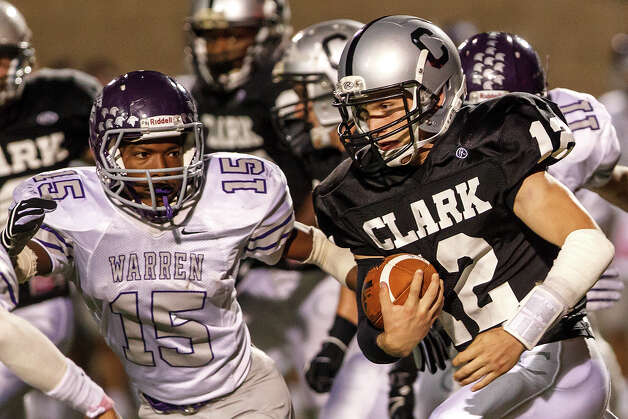 Warren's Tamarian Torns (left) tracks down Clark quarterback Chase Jones during the fourth quarter of their game at Farris Stadium on Nov. 9, 2012.  Clark claimed a spot in the playoffs with a 27-26 overtime victory over the Warriors.  MARVIN PFEIFFER/ mpfeiffer@express-news.net Photo: MARVIN PFEIFFER, Express-News / Express-News 2012