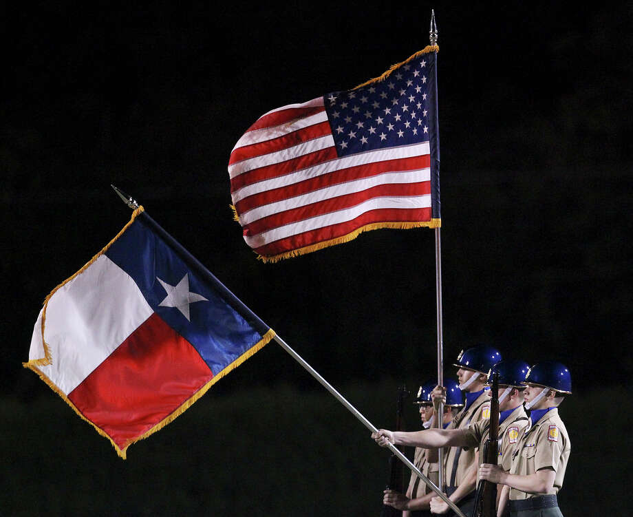 The Alamo Heights ROTC honor guard presents the colors prior to the start of the Mules' football game against Buda Hays at Alamo Heights on Friday, Nov. 9, 2012. Photo: Kin Man Hui, Express-News / © 2012 San Antonio Express-News