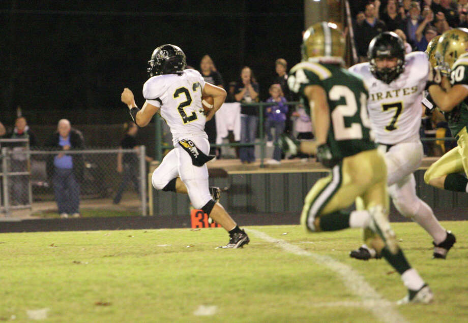 Vidor?s Montana Quirante rushes for a touchdown during the game against LCM Friday at Bear Stadium in Orange. (Matt Billiot/Special to the Enterprise)