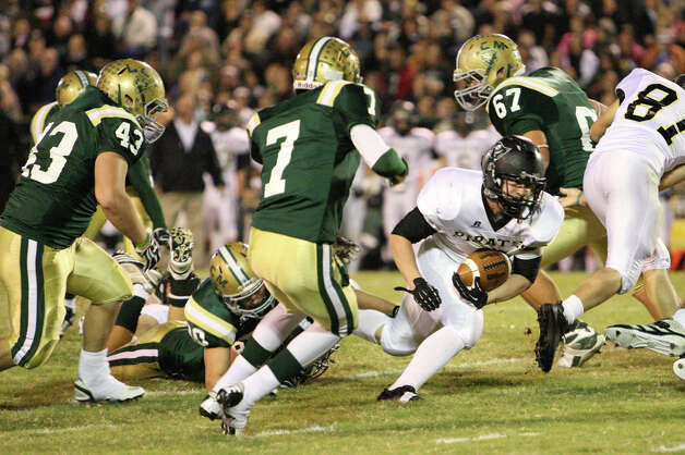 Vidor?s Justin Moore rushes during the game against LCM Friday at Bear Stadium in Orange. (Matt Billiot/Special to the Enterprise)