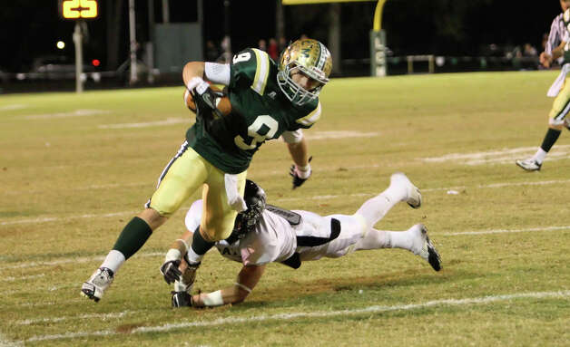 LCM?s Dalton Doyle, No. 9, is tackled by a Vidor player during the game against Vidor Friday at Bear Stadium in Orange. (Matt Billiot/Special to the Enterprise)