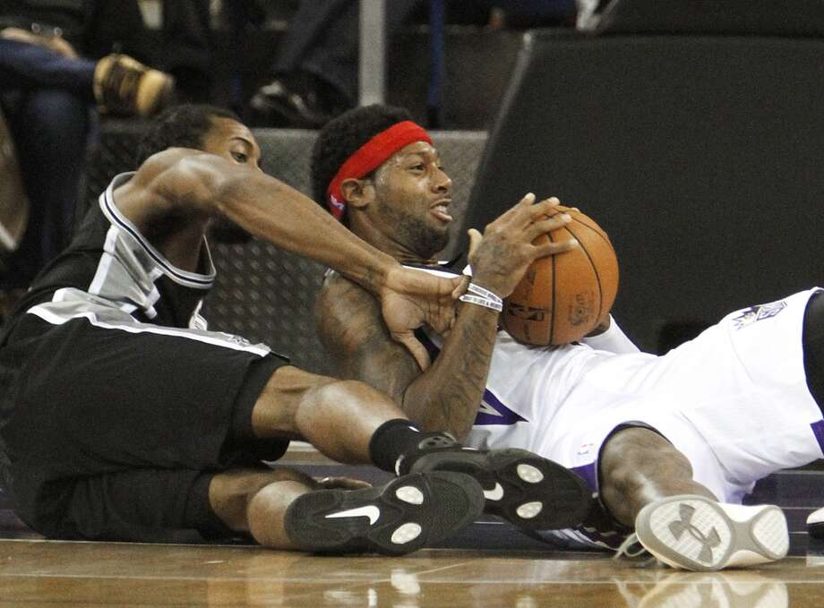 Sacramento Kings forward James Johnson, right, protects the ball from San Antonio Spurs forward Kawhi Leonard  during the first quarter of an NBA basketball game in Sacramento, Calif., Friday, Nov. 9, 2012. (AP Photo/Rich Pedroncelli) (Associated Press)
