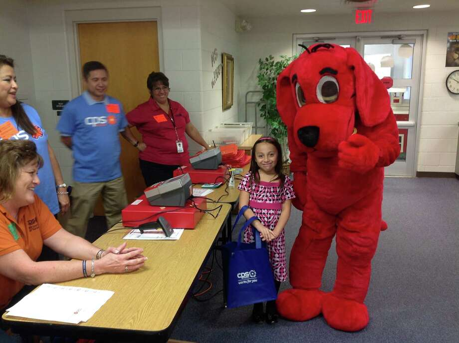 Clifford the Bid Red Dog, the mascot for Scholastic Book Fairs; and a student at Sarah King Elementary; share a smile together. Photo: Courtesy Photo